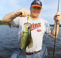 image of Joel Clusiau with big Crappie