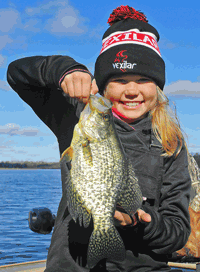 image of Claire Clusiau with giant Crappie