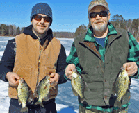 Andy and Bruce Clusiaua holding crappies