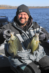 image of Travis Sorokie with big Crappies