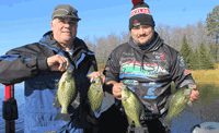 image of Mike and Andy Walsh with big Crappies