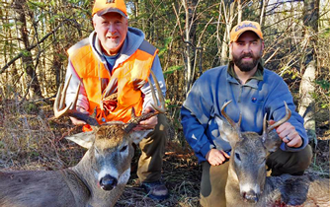 image of dave and andy arolas with bucks