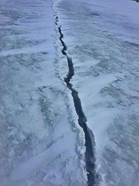 image of crack in ice at red lake