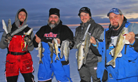 image of red lake ice fishermen with lots of Walleyes