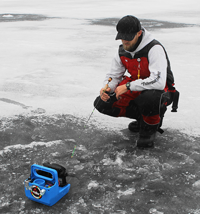 image of Justin Bailey ice fishing