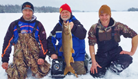 image of ice fishermen with Lake Trout