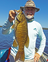 image of greg clusiau with big smallmouth bass