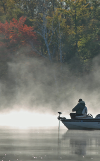 image of fisherman in steamy water