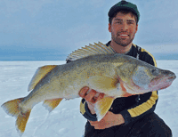 image of Mike Walsh holding monster Lake Winnipeg Walleye