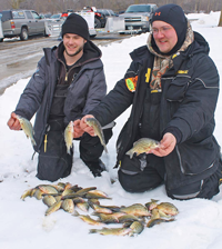 image of Schuttler and Lauber display winning catch of yellow bass
