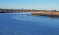 image of Bowstring River covered with ice