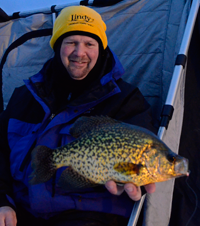 image of Jon Thelen with giant Crappie