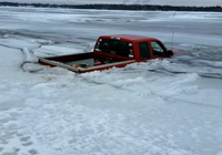 image of pickup truck breaking through ice on Pokegama Lake