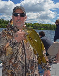image of Phil Goettl with Smallmouth Bass