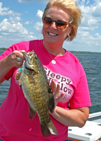image of Mari Petersen with big Smallmouth