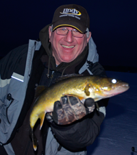 image of Arne Danielson holding big Walleye