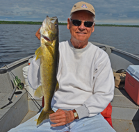 image of Bob Carlson holding big walleye