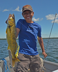 image of Miguel holding big Walleye