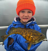 image of Asher Roth with big smallmouth bass