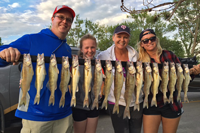 image of family with stringer of walleyes