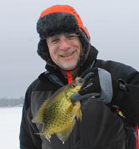 image of ice fisherman holding big crappie