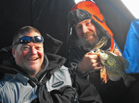 image of 2 ice fishermen holding crappies