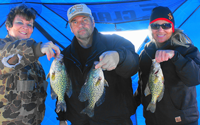 image of ice fishing party with big crappies