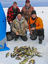 image of ice fishing party with fish on ice