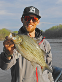 image of Justin Bailey with big White Bass