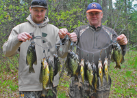 image of joel and jesse clusiau with stringer of crappies