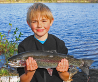 image of jordan tew with beautiful Rainbow Trout