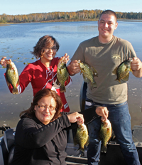 image of family all holding crappies