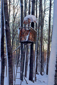 image of snow covered deer stand