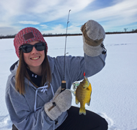 image of steph torgeson holding sunfish