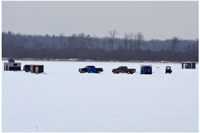 image of pickup trucks on the ice