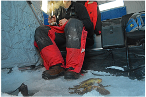 image of ice fisherman with fish