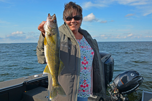 image of the hippie chick with Mille Lacs walleye