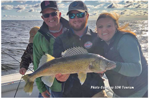 image of guide and crew with big walleye