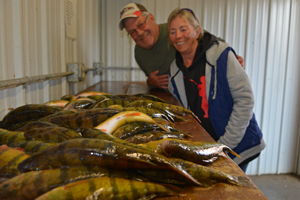 image of keith & diane eberhardt with big perch