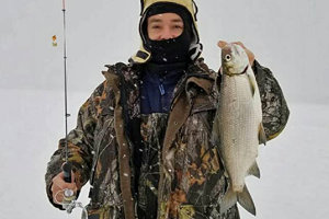 image of ice fisherman with big tulibee