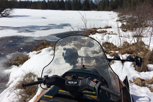 image of snowmobile on remote lake