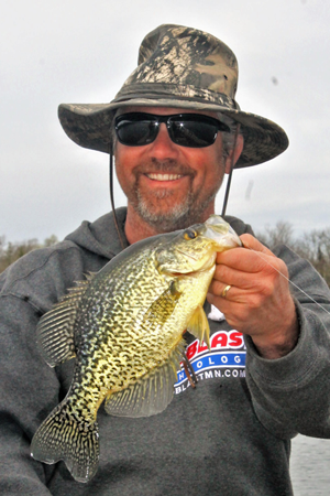 image of fisherman with crappie
