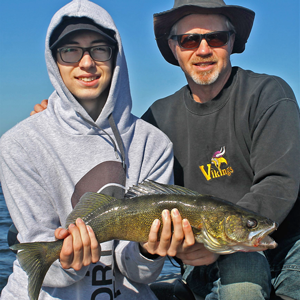 image of casey clusiau with walleye