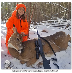 image of aubrey bailey with first deer
