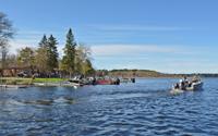 image of boats leaving resort dock