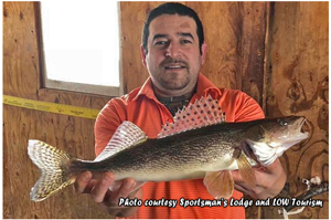 image of angler with big sauger