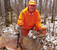 image of Harry Hagsten with Buck Deer