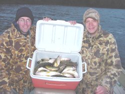 image of anglers with cooler full of walleyes